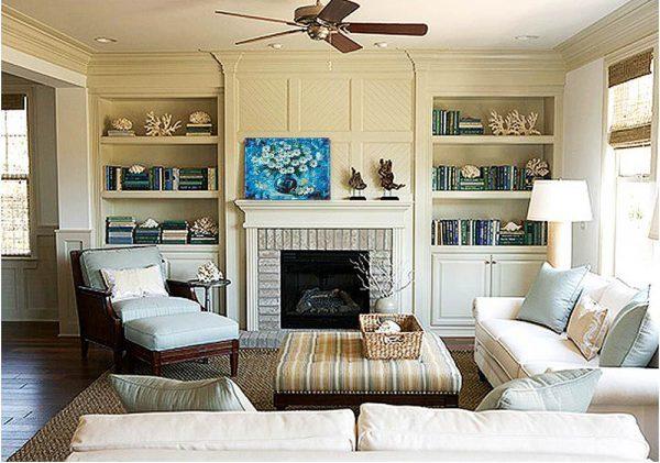 Красивое оформление камина в интерьере гостиной и столовой