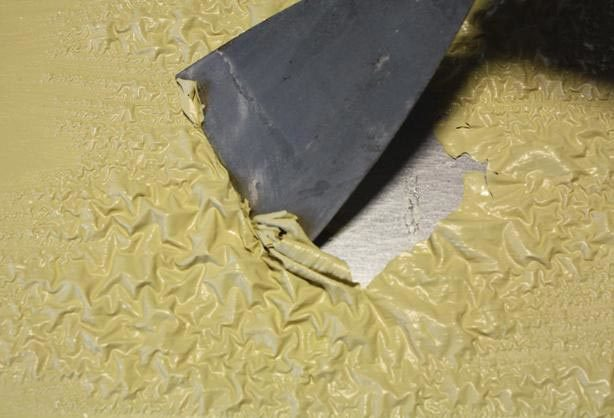 Как удалить старую краску со стен?
